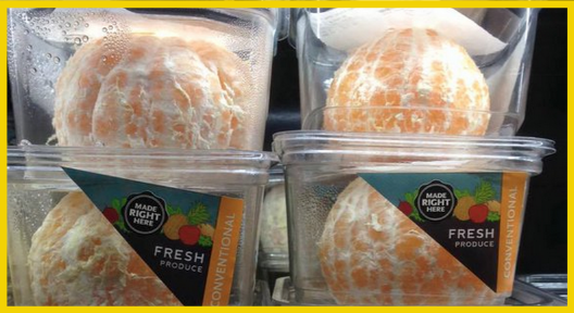 Pre-peeled orange in plastic container